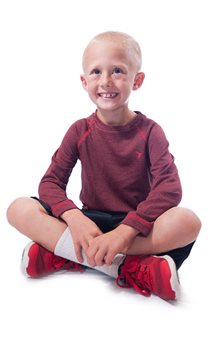 Happy, sitting child with a healthy smile thanks to Great Grins for KIDS - Portland, OR